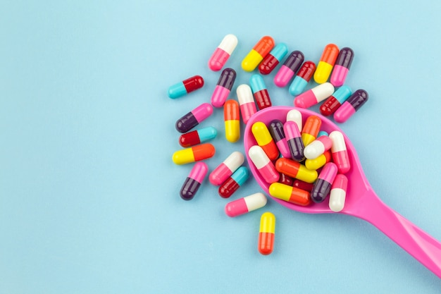 Colorful medicine capsules with spoon