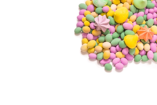 Colorful meringues and glazed peanuts isolated on white.op view.