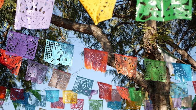 Colorful mexican papel picado banner, paper garland. holiday decoration or carnival flags.