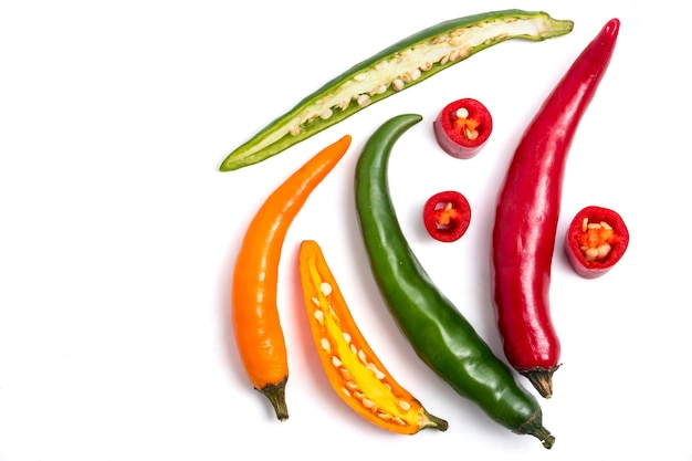 Colorful mix of chili peppers on white background.