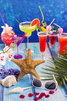 Colorful mixed cocktails in tropical blue wood