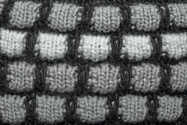 Красочная пятнистая и пятнистая нить вязать предпосылку текстуры шерсти.