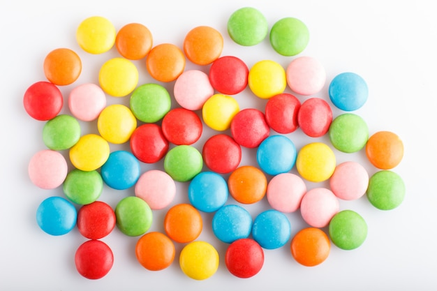 Colorful  multicolored chocolate candy dragees isolated on white background