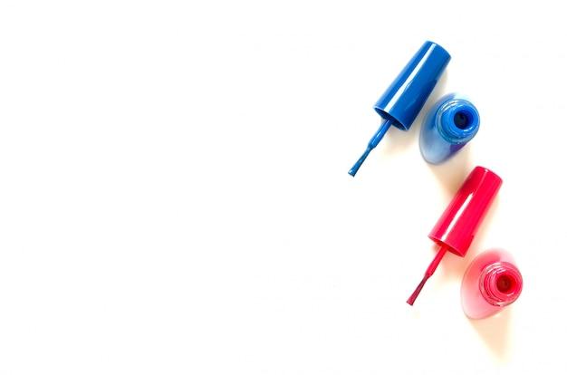 Colorful nails polish bottles isolated on white