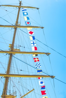 Colorful nautical sailing flags flying in the wind