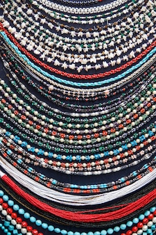 Colorful necklaces on a market close up