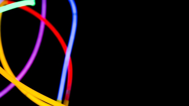 Colorful neon lights on black background