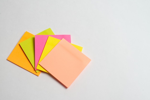 Colorful note sticks on white background