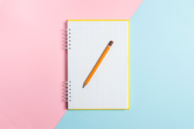 On colorful a notebook with a pencil