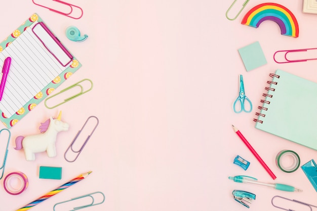 Colorful office supplies with copy space in the middle