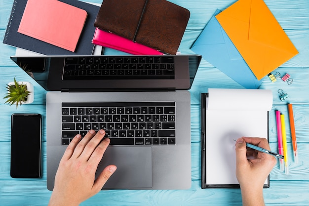 Colorful office supplies with laptop