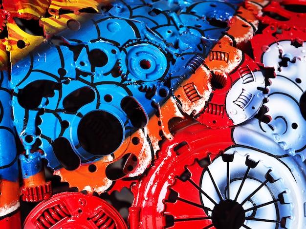 Colorful oil paint on a part machine closeup.