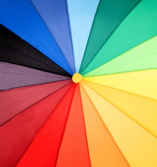 Colorful opened umbrella with all the colors of the rainbow