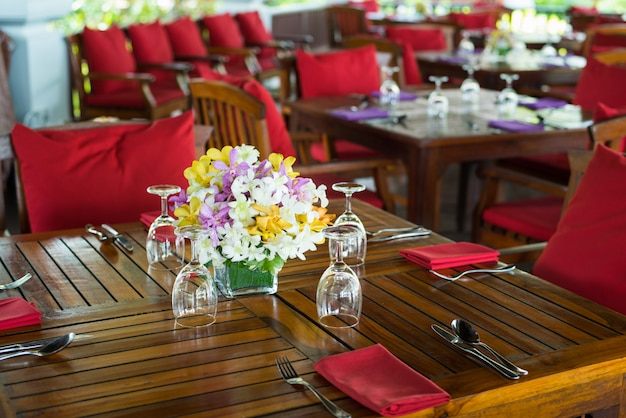 Colorful orchid decor on india wedding dinner