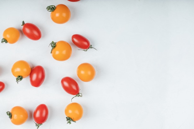 Colorful organic tomatoes on white background. high quality photo