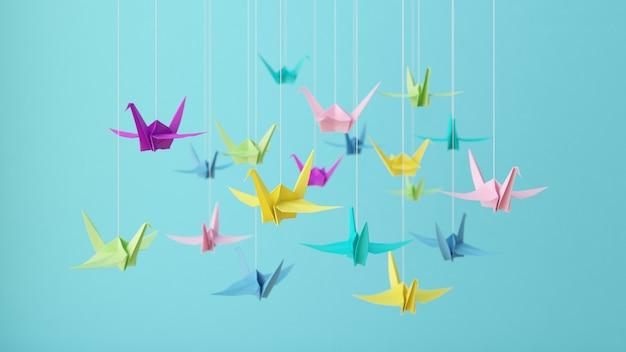 Красочные бумажные журавлики оригами