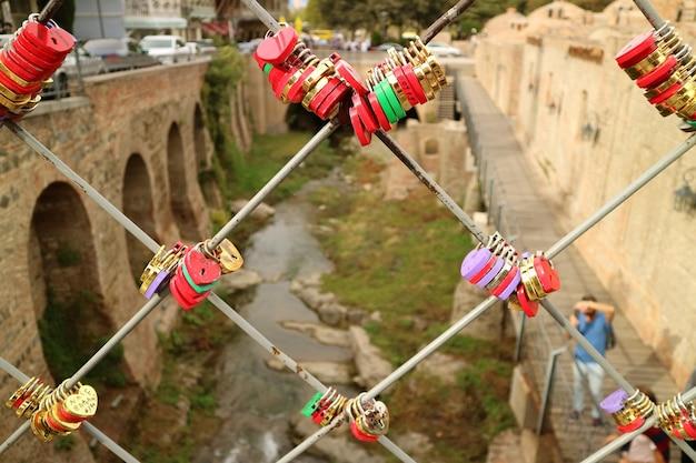 Colorful padlocks on the bridge of lovers, old tbilisi, georgia