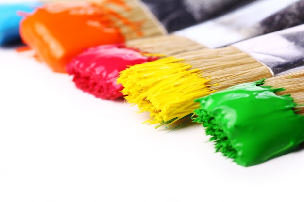 Colorful paint and brushes