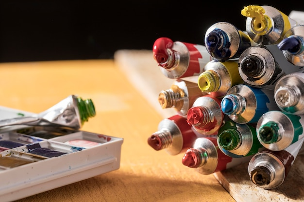 Colorful paint tubes with palette