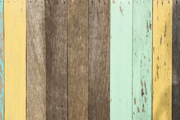 Colorful paint on wooden board., color texture background.