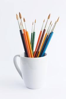 Colorful paintbrush in ceramic glass