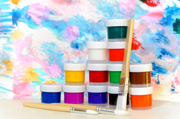 Colorful paints and brushes