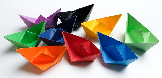 Colorful paper boats on a bright blue.