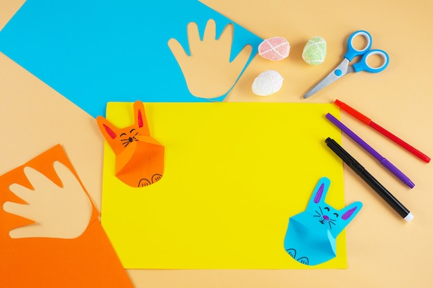 Colorful paper bunnies from childrens palm of their hand