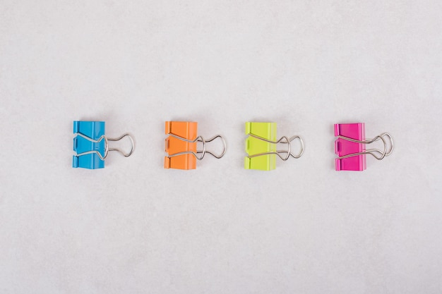Colorful paper clips on white background. high quality photo