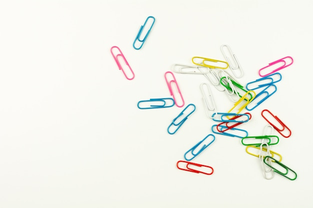 Colorful paper clips on white background. - top view.