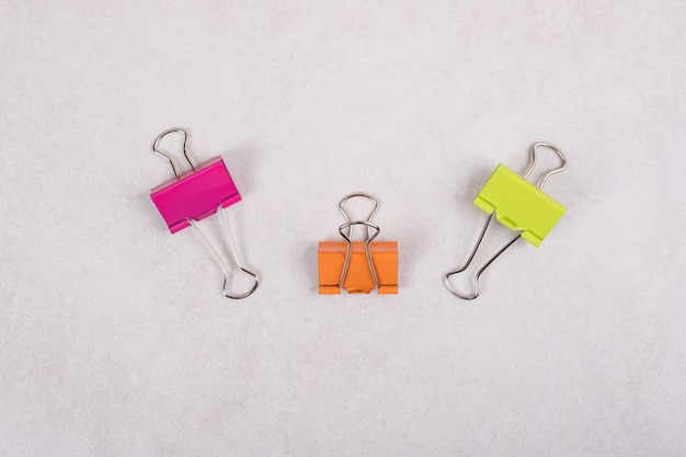 Colorful paper clips on white background.