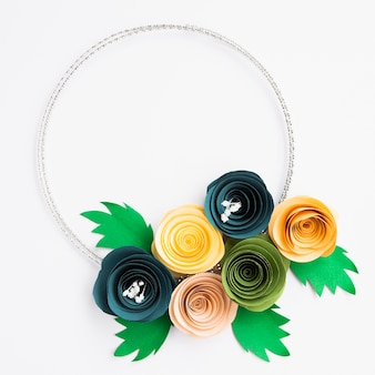 Colorful paper flowers frame on white background