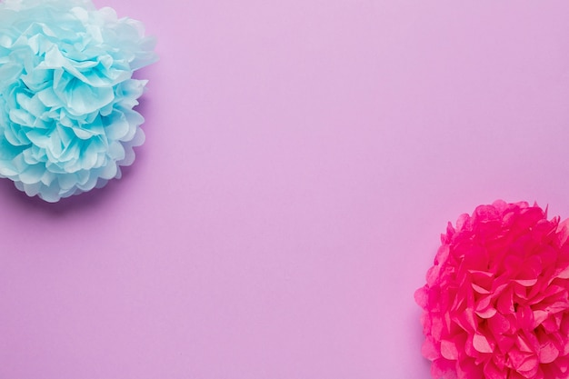 Colorful paper flowers with copy space