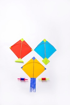 Colorful paper kites and string , makar sankranti festival concept