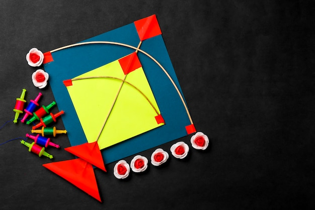 Colorful paper kites and string , makar sankranti festival concept