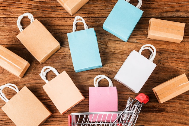 Colorful paper shopping bags in a trolley ideas about online shopping addiction
