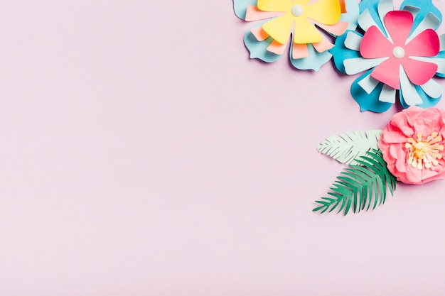 Colorful paper spring flowers with copy space