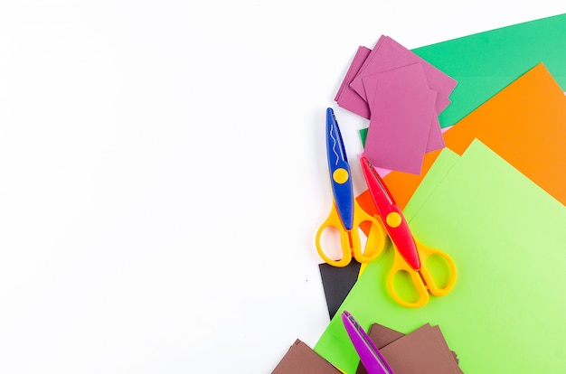 Colorful paper with scissors for children on a white background