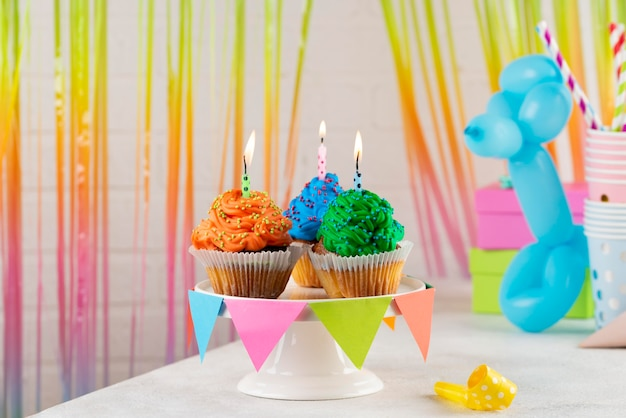 Colorful party cupcakes with candles