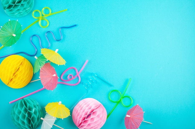 Colorful party decoration and accessories over the bleu background. summer beach parties and celebration
