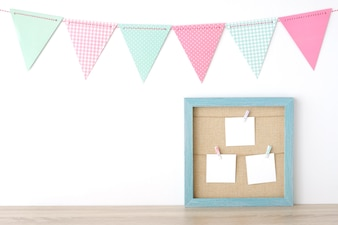 Colorful party flags hanging over blue vintage wooden frame