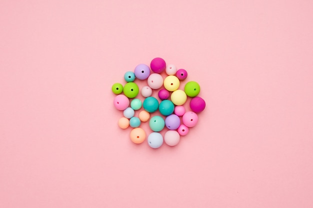 Colorful pastel beads in a circle. girly minimalist composition