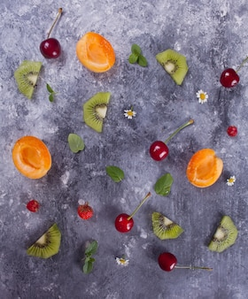 Colorful pattern made of fruits, leaves and berries
