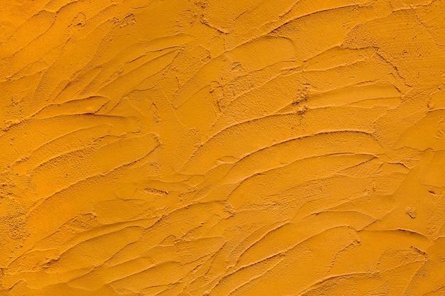カラフルなパターンと黄色のセメントの背景の表面。