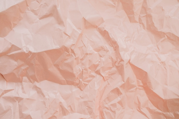 Colorful peachy crumpled paper texture