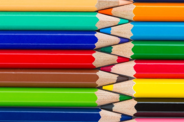 Colorful pencils arranged in a row close up