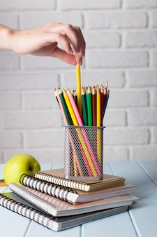 Colorful pencils in modern classroom