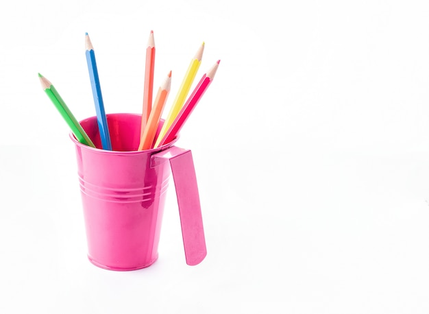 Colorful pencils in pail isolated on white. creative idea for drawing and style.