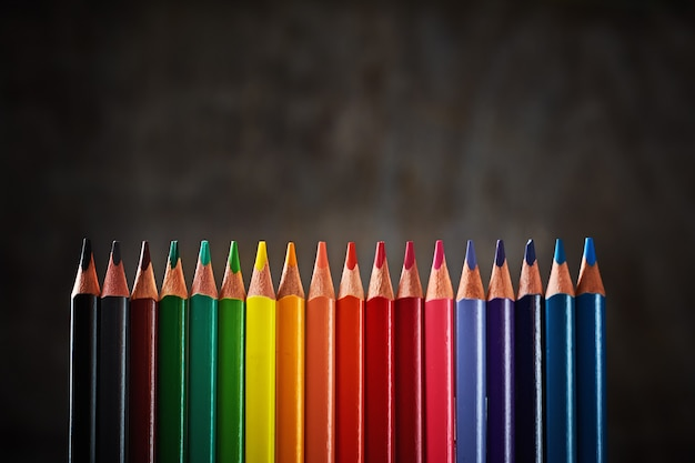 Colorful pencils in row