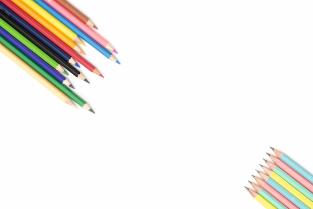 Colorful pencils on white background with copyspace